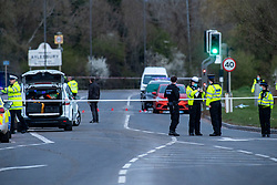 © Licensed to London News Pictures. 16/04/2021. Aylesbury, UK. Police officers stand in front of an inner cordon following the death of a pedestrian, a 25-year-old woman from Aylesbury, on the A41 Bicester Road between Paradise Orchard and Jackson Road in Aylesbury. The pedestrian was struck by a police vehicle at approximately 17:50 BST on Friday 16th April while responding to a separate collision on the same road approximatly 2 miles to the west in Waddesdon. Thames Valley Police has made a mandatory referral to the Independent Office for Police Conduct (IOPC) following the collision. Photo credit: Peter Manning/LNP