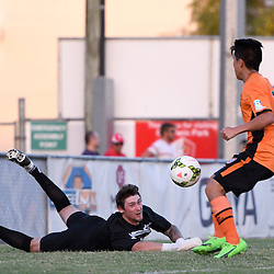 BRISBANE, AUSTRALIA - FEBRUARY 25: Olympic FC goalkeeper Thomas Carroll attempts to stop the Brisbane Roar cross during the NPL Queensland Senior Men's Round 1 match between Olympic FC and Brisbane Roar Youth at Goodwin Park on February 25, 2017 in Brisbane, Australia. (Photo by Patrick Kearney/Olympic FC)