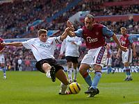 Photo: Glyn Thomas.<br />Aston Villa v Liverpool. The Barclays Premiership. <br />05/11/2005.<br />Liverpool's Steven Gerrard (L) slides in with a challenge on Gavin McCann.