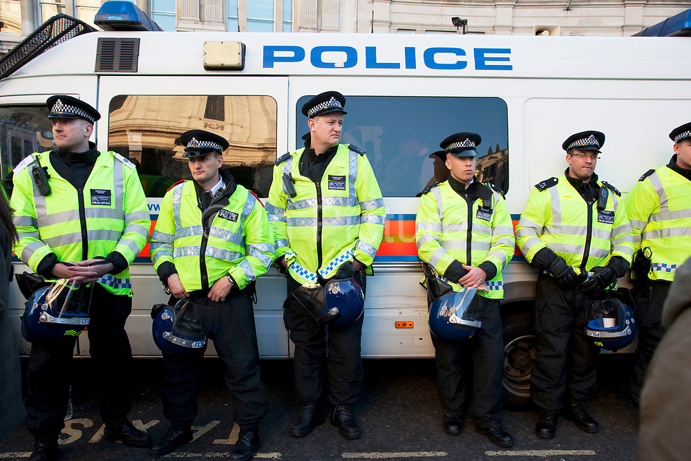 """Police lines at Occupy London protest at St Pauls, October 15th 2011. Protest spreads from the US with this demonstrations in London and other cities worldwide. The 'Occupy' movement is spreading via social media. After four weeks of focus on the Wall Street protest, the campaign against the global banking industry started in the UK this weekend, with the biggest event aiming to """"occupy"""" the London Stock Exchange. The protests have been organised on social media pages that between them have picked up more than 15,000 followers. Campaigners gathered outside  at midday before marching the short distance to Paternoster Square, home of the Stock Exchange and other banks.It is one of a series of events planned around the UK as part of a global day of action, with 800-plus protests promised so far worldwide.Paternoster Square is a private development, giving police more powers to not allow protesters or activists inside."""