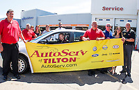 Kyle Bigler sits behind the wheel of his new 2005 Honda Accord from AutoServe of Tilton on Tuesday morning.  (L-R back row) Paul Gaudet Jr., Donna Hosmer, Carolyn Gaudet, Chelsey Gaudet, Michael Tessier. (L-R front row) Tim VanGelder, Kyle Bigler, Harry Nadeau, Warren Bailey, Joanna Griffiths and Eric Binder.    (Karen Bobotas/for the Laconia Daily Sun)