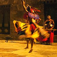 Asia, Bhutan, Thimpu. Traditional Bhutanese dancer at the Taj Tashi Hotel.