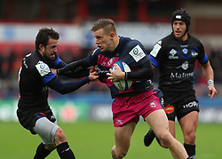 Gloucester Rugby's Jason Woodward (centre) and Castres Olympique's Martin Laveau battle for the ball during the European Champions Cup, pool two match at Kingsholm Stadium, Gloucester.