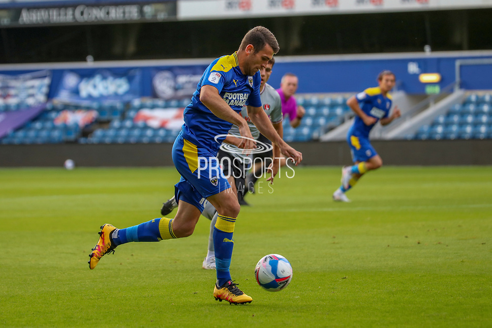 AFC Wimbledon attacker Adam Roscrow (10) dribbling during the EFL Trophy Group O match between AFC Wimbledon and Charlton Athletic at the Kiyan Prince Foundation Stadium, London, England on 1 September 2020.