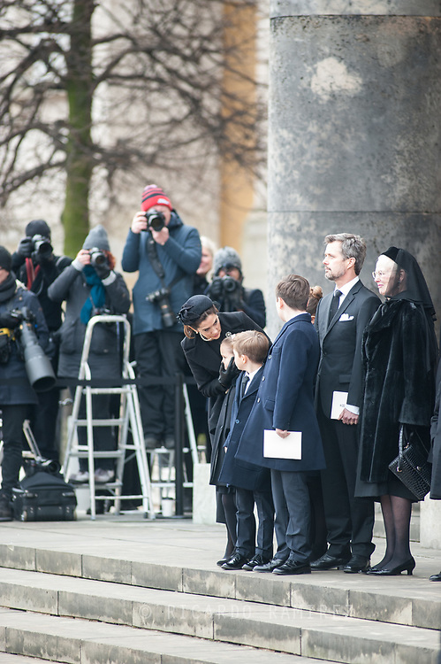 20.02.2018. Copenhagen, Denmark. <br /> Crown Princess Mary,  Crown Prince Frederik, Princess Josephine, Prince Vincent, Prince Christian, Princess Isabela, Queen Margrethe II  on the steps of the church, looking on as the car carrying Prince Henrik departs following the service.<br /> Photo: Ricardo Ramirez.