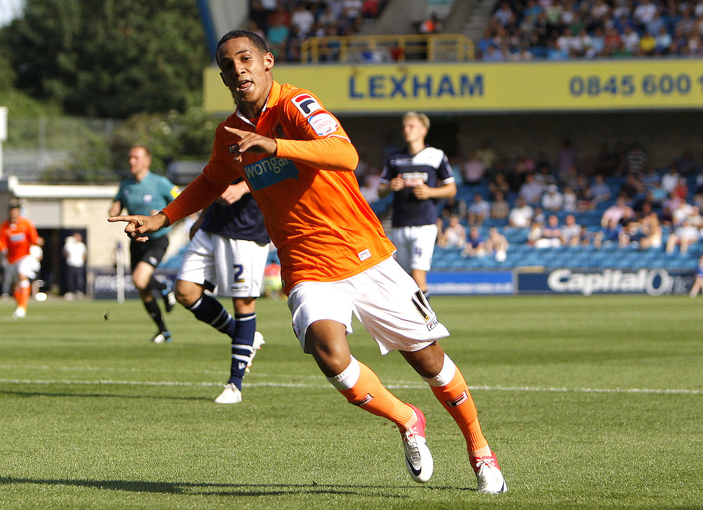 Blackpool's Thomas Ince celebrates scoring his sides second goal 2-0..Football - npower Football League Championship - Millwall v Blackpool - Saturday 18th August 2012 - The Den - Millwall - London..