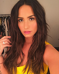 """Demi Lovato releases a photo on Instagram with the following caption: """"\ud83d\udc9b\ud83d\udc9b\ud83d\udc9b"""". Photo Credit: Instagram *** No USA Distribution *** For Editorial Use Only *** Not to be Published in Books or Photo Books ***  Please note: Fees charged by the agency are for the agency's services only, and do not, nor are they intended to, convey to the user any ownership of Copyright or License in the material. The agency does not claim any ownership including but not limited to Copyright or License in the attached material. By publishing this material you expressly agree to indemnify and to hold the agency and its directors, shareholders and employees harmless from any loss, claims, damages, demands, expenses (including legal fees), or any causes of action or allegation against the agency arising out of or connected in any way with publication of the material."""