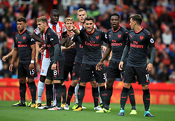 """Arsenal's Sead Kolasinac and teammates before a corner-kick during the Premier League match at the bet365 Stadium, Stoke. PRESS ASSOCIATION Photo. Picture date: Saturday August 19, 2017. See PA story SOCCER Stoke. Photo credit should read: Mike Egerton/PA Wire. RESTRICTIONS: EDITORIAL USE ONLY No use with unauthorised audio, video, data, fixture lists, club/league logos or """"live"""" services. Online in-match use limited to 75 images, no video emulation. No use in betting, games or single club/league/player publications."""