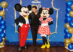 © Licensed to London News Pictures. 29/12/2014London, UK. Peter Andre meets Mickey Mouse and Minnie Mouse at Disney On Ice celebrates 100 Years of Magic at the O2, London.  Photo credit : Simon Jacobs/LNP