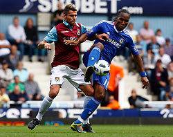 11.09.2010, Boleyn Ground Upton Park, London, ENG, PL, West Ham United vs FC Chelsea, im Bild Chelsea's Ivory Coast footballer Didier Drogba holds of Valon Behrami of West Ham United Barclays Premier League West Ham United v Chelsea.at Boleyn Ground Upton Park. EXPA Pictures © 2010, PhotoCredit: EXPA/ IPS/ Kieran Galvin +++++ ATTENTION - OUT OF ENGLAND/UK +++++ / SPORTIDA PHOTO AGENCY