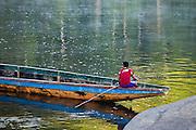 Boat driver in dugout canoe on the Rio Caura, Venezuela