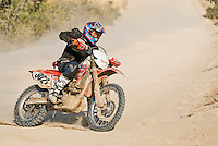 Racer Mouse Mccoy near Todos Santos, 80 miles from finish of 2007 Baja 1000. Team finished in first place for Class 30 motorcycle with a time of 26:48:15