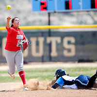 041313       Adron Gardner/Independent<br /> <br /> Monument Valley Mustang Amber Whitehair (15), tries to turn a double play after Window Rock Scout Courage  Todachine (8) is out at second base in Fort Defiance Saturday.