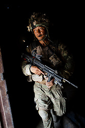 © London News Pictures. 17.01.12. FILE PICTURE. 400 Gurkhas with more than six years' service would be made redundant under MOD plans along with 500 infantry privates. A Gurkha from 1st Battalian the Royal Gurkha Rifles in Nahr-e-Saraj, Helmand, Afghanistan. August, 2010. Photo: Sean Power/London News Pictures.