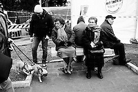 "ROME, ITALY - 22 FEBRUARY 2013: Beppe Grillo, a comedian and leader of the 5 Stars Movement (M5S, Movimento 5 Stelle) rallies during the last rally of his ""Tsunami Tour"" in Piazza San Giovanni, in Rome on February 22, 2013. Wrapping up his election campaign in Rome, Grillo said ""there are 800,000 thousand of you here - with 150,000 watching our live streaming, and 120 squares in Italy watching us"".<br /> <br /> Grillo, whom presents itself as a ""non-politician"", and the 5 Stars Movement as ""not a party"", has been running a mostly internet-based political campaign through the party's blog and the local groups that have emerged from it. The movement has a strong anti-politics agenda: ""All political parties are crooked and they all need to go"", Grillo says.<br /> <br /> <br /> A general election to determine the 630 members of the Chamber of Deputies and the 315 elective members of the Senate, the two houses of the Italian parliament, will take place on 24–25 February 2013. The main candidates running for Prime Minister are Pierluigi Bersani (leader of the centre-left coalition ""Italy. Common Good""), former PM Mario Monti (leader of the centrist coalition ""With Monti for Italy"") and former PM Silvio Berlusconi (leader of the centre-right coalition).<br /> <br /> ###<br /> <br /> ROMA, ITALIA - 22 FEBBRAIO 2013: Beppe Grillo, comico e leader del Movimento 5 Stelle (M5S), fa un comizio durante la tappa finale dello ""Tsunami Tour""  a Piaza San Giovanni, a Roma il 22 febbraio 2013. A conclusione del comizio, Beppe Grillo ha dichiarato: ""Siamo 800.000 e 150.000 in streaming, con 120 piazze collegate"".<br /> <br /> Grillo, il quale si presenta come un ""non-politica"", e il Movimento 5 Stelle come un ""non-partito"", svolge la maggior parte della propria campagna elettorale su internet, tramite il suo blog e i meetup locali. Il movimento ha un'agenda dalle connotazioni antipolitiche: ""I partiti sono finiti e i politici se ne devono andare"", sostiene Grillo.<br /> <br /> Le elezi"