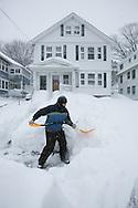 Boston, MA 02/09/2013<br /> Katie O'Neil shovels out her sidewalk on Willow St. in West Roxbury.