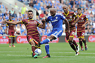 QPR's Steven Caulker (l) blocks Cardiff's Frederic Gounongbe's shot at goal. EFL Skybet championship match, Cardiff city v Queens Park Rangers at the Cardiff city stadium in Cardiff, South Wales on Sunday 14th August 2016.<br /> pic by Carl Robertson, Andrew Orchard sports photography.