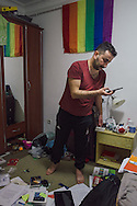 Nader, a gay man from Homs, Syria, packs his belongings at home in Istanbul, Turkey, on the eve of his departure to Norway after being granted political asylum. He will leave behind his job, his friends and his fiancé, Omar.