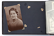 a 1930s portrait and a missing picture on a vintage photo album page