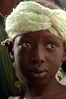 BURKINA FASO, Gorom-Gorom, 2007. A curious Fulani girl watches the proceedings as traders arrive for Gorom-Gorom's Thursday market, which serves the whole region.