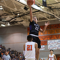 Miyamura Patriot Cael Stewart (22) drives to the basket for a layup while Gallup Bengal Jeffrey Yazzie (21) draws the charge foul during their 1-4A semi-final tournament game Wednesday night at Gallup High School. Gallup took the win 72-39.