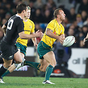 Quade Cooper, Australia on the ball watch by his opposite number Dan Carter during the New Zealand V Australia Tri-Nations, Bledisloe Cup match at Eden Park, Auckland. New Zealand. 6th August 2011. Photo Tim Clayton