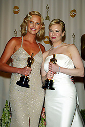 Feb 29, 2004; Hollywood, CA, USA; OSCARS 2004: Actresses CHARLIZE THERON and RENNE ZELLWEGER in the press room at the 76th Annual Academy Awards held at the Kodak Theatre in Hollywood..  (Credit Image: Lisa O'Connor/ZUMAPRESS.com)