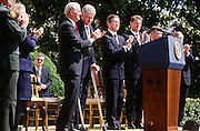 President Bill Clinton with James Baker, William Cohen and Al Gore during an event on the Chemical Weapons Ban treaty at the White House event April 4,1997 in Washington, DC.