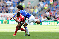 Everton's Marouane Fellaini fouls Cardiff's Fraizer Campbell.  Barclays Premier league, Cardiff city v Everton at the Cardiff city Stadium in Cardiff,  South Wales on Saturday 31st August 2013. pic by Andrew Orchard,  Andrew Orchard sports photography,
