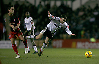 David Jones of Derby County (right) is tackled by Lee Hendrie of Stoke City (left)