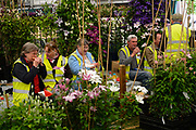 Staff break for lunch during preparations for the Chelsea Flower Show, London, UK. The RHS Chelsea Flower Show, formally known as the Great Spring Show, is a garden show held for five days in May by the Royal Horticultural Society. It is the most famous flower show in the United Kingdom, and perhaps in the world, attracting visitors from all continents.
