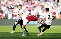 West Ham United's Marko Arnautovic (front) and Manchester United's Scott McTominay battle for the ball during the Premier League match at London Stadium.
