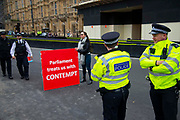 Police officers and a pro leave protesters outside the Houses of Parliament on 9th September 2019 in London, United Kingdom. Prime Minister Boris Johnson is tabling another motion to seek a general election.
