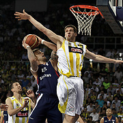 Fenerbahce Ulker's Gasper VIDMAR (R), Emir PRELDZIC (L), Roko Leni UKIC (2ndL) and Efes Pilsen's Mario KASUN (C) during their Turkish Basketball league Play Off Final fourth leg match Fenerbahce Ulker between Efes Pilsen at the Abdi Ipekci Arena in Istanbul Turkey on Thursday 27 May 2010. Photo by Aykut AKICI/TURKPIX