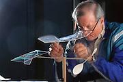 Moffett field blimp hanger/ Mountain view, California. Ultralight model plane with rubber band Power built by John Petrek, a United Airlines pilot. MODEL RELEASED.