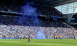 The match is briefly stopped after a flare is thrown on to the pitch during the Sky Bet Championship match at the Cardiff City Stadium.