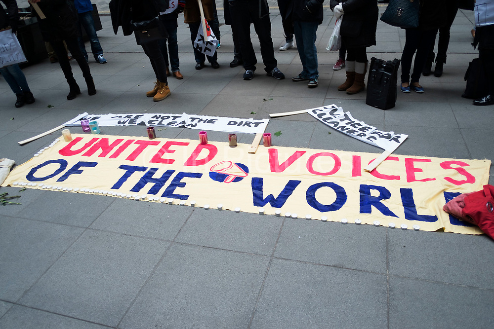"""Protest for Fernando Montero outside his old workplace. London, UK. On 17th December 2015, Fernando Montero died following a heart attack. For the last 5 years he was employed as a cleaner by outsourcing giant Servest at the Willis Building, in the City. During this time, he was victim of a destructive workplace culture. His supervisors repeatedly shouted at him in public, refused him the right to use the toilet outside of break time, and failed to grant him annual leave. On the day of his death, Fernando called a friend in a state of distress. Too anxious to return to work, due to the treatment of himself and fellow workers. A few hours later, he was dead. For his wife Francia, the link between workplace stress and his death is straightforward: """"He passed away of a heart attack because of the stress brought about by the abuse and bullying of his bosses."""""""