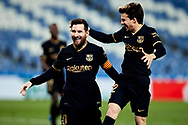 Lionel Andres Messi celebrates with his teammate Ricard Puig after scoring during the La Liga match between Real Sociedad CF and FC Barcelona at Reale Arena on March 21, 2021 in San Sebastian, Spain.