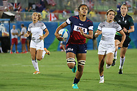 August 08, 2016; Rio de Janeiro, Brazil; USA Women's Eagles Sevens Joanne Fa'avesi breaks through the French defense during the Women's Rugby Sevens 5th Place Play-Off match on Day 3 of the Rio 2016 Olympic Games at Deodoro Stadium. Photo credit: Abel Barrientes - KLC fotos