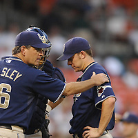 01 June 2007:  San Diego Padres pitcher Jake Peavy (R) gets a pat on the shoulder from pitching coach Darren Beasley (36) during the game against the Washington Nationals.  Peavy struck out 7 in seven innings, giving up 3 earned runs as the Nationals defeated the Padres 4-3 in 10 innings at RFK Stadium in Washington, D.C.  ****For Editorial Use Only***