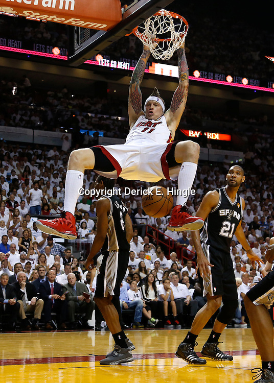 Jun 9, 2013; Miami, FL, USA;  Miami Heat power forward Chris Andersen (11) dunks against San Antonio Spurs small forward Kawhi Leonard (2) and power forward Tim Duncan (21) during the first quarter of game two of the 2013 NBA Finals at the American Airlines Arena. Mandatory Credit: Derick E. Hingle-USA TODAY Sports