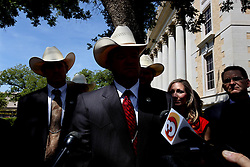 """Texas Rangers talk to the media after polygamist leader Warren Jeffs, who heads the Fundamentalist Church of Jesus Christ of Latter-Day Saints, was sentenced to life in prison for sexually assaulting two underage girls he claimed as """"spiritual"""" brides. The Texas jury of ten women and two men deliberated for less than an hour before giving him a life sentence for one charge and 20 years for a second, the maximum sentence for both. San Angelo, Texas, Aug. 9, 2011."""