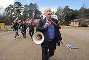 A group of protesters march to Jena High School on the Martin Luther King Jr. holiday in Jena, La., Monday, Jan. 21, 2008. The protest was organized by the self-described 'pro-majority' Nationalist Movement of Learned, Mississippi, lead by Richard Barrett, and was being held in opposition to the six black teenagers who were arrested in the beating of a white classmate in December 2006, and the King holiday. The protest drew about 50 participants and 100 counter-demonstrators to Jena.(Photo/© Suzi Altman) The Rankin County Sheriff's Department has confirmed that the body of white supremacist and attorney Richard Barrett, 67, was found in his Pearl home today, apparently the victim of a homicide.