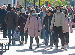 © Licensed to London News Pictures 21/10/2021.<br /> Bromley, UK, Some young people are wearing masks as they shop in Bromley High Street, South East London. The coronavirus infection rate continues to rise as the Health Secretary Sajid Javid warning that cases could hit 100,000 a day in the winter months. Photo credit:Grant Falvey/LNP