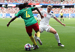 Cameroon's Yvonne Leuko (left) and England's Ellen White battle for the ball during the FIFA Women's World Cup, round of Sixteen match at State du Hainaut, Valenciennes.