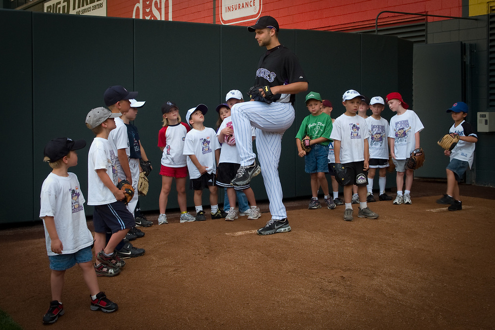 TAYLOR BUCHHOLZ, pitcher for the Colorado Rockies, shows how a proper knee lift helps.