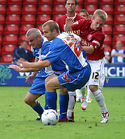 Photo: Dave Linney.<br />Walsall v Hartlepool United. Coca Cola League 2. 12/08/2006.No way past Hartlepools Matty Robson(L) for Walsall's Dean Keats