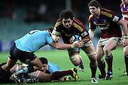 Nasi Manu is taken by Al Baxter. NSW Waratahs v Otago Highlanders. Investec Super Rugby Round 17 Match, 11 June 2011. Sydney Football Stadium, Australia. Photo: Clay Cross / photosport.co.nz