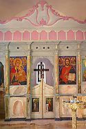 Interior of a chapel and Orthodox icons of the Byzantine of Nea Moni built by Constantine IX and Empress Zoe after the miraculous appearance of an Icon of the Virgin Mary at the site and inaugurated in 1049. Scene of a terrible sack and massacre of hundreds of Chiots and priests during the Ottoman sack of Chios in reprisal for the 1821 Greek War of Indipendance. Nea Moni monastery, Chios Island, Greece. A UNESCO World Heritage Site. .<br /> <br /> If you prefer to buy from our ALAMY PHOTO LIBRARY  Collection visit : https://www.alamy.com/portfolio/paul-williams-funkystock/chios.html<br /> <br /> Visit our GREECE PHOTO COLLECTIONS for more photos to download or buy as wall art prints https://funkystock.photoshelter.com/gallery-collection/Pictures-Images-of-Greece-Photos-of-Greek-Historic-Landmark-Sites/C0000w6e8OkknEb8