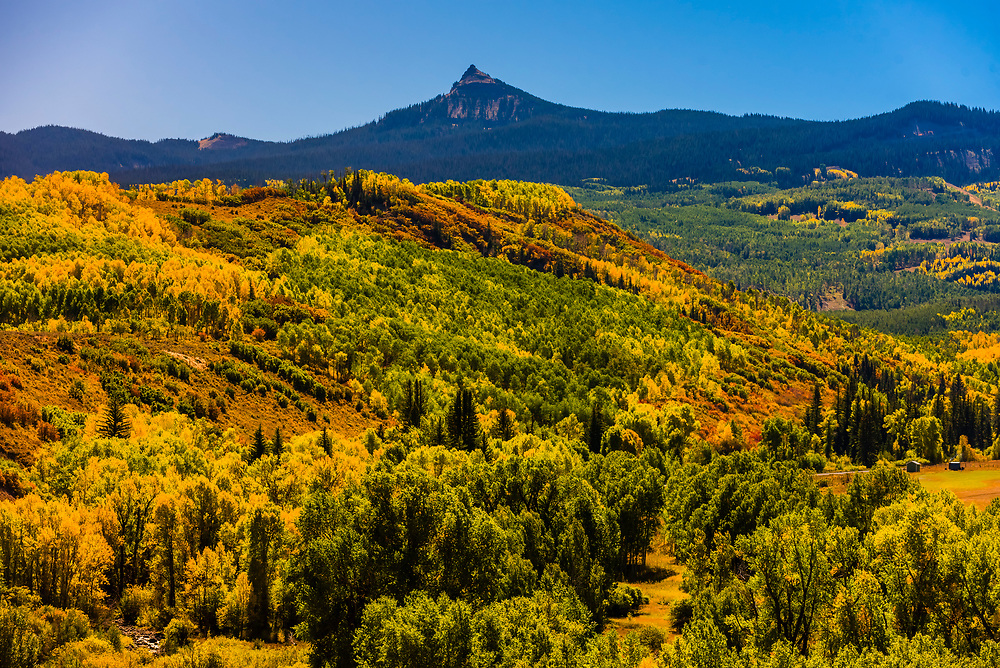 The Flat Tops Trail Scenic Byway (with the Flat Tops Mountain Range in the background), between Yampa and Meeker, Colorado USA.